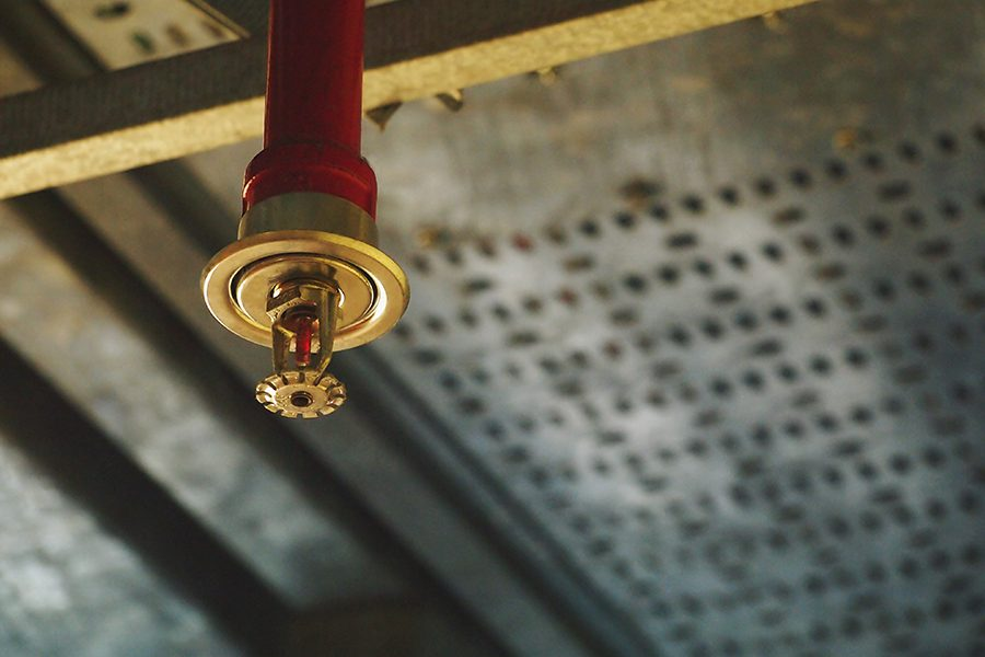 Fire Protection Contractor Insurance - Installation of an Automatic Fire Sprinkler System with Pipe in Red