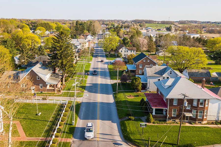Wapakoneta, OH - Aerial of the Small Town Surrounded by Farmland Displaying One Main Road for the Town