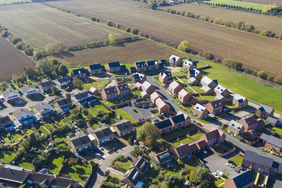 Waynesfield, OH - Aerial View of Homes in a Rural Town Displaying Homes and Farmlands