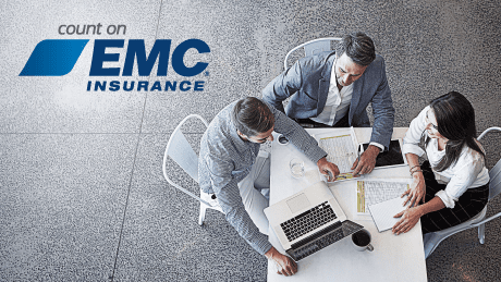 EMC Insurance logo and a group of business people sitting around a table at a meeting.