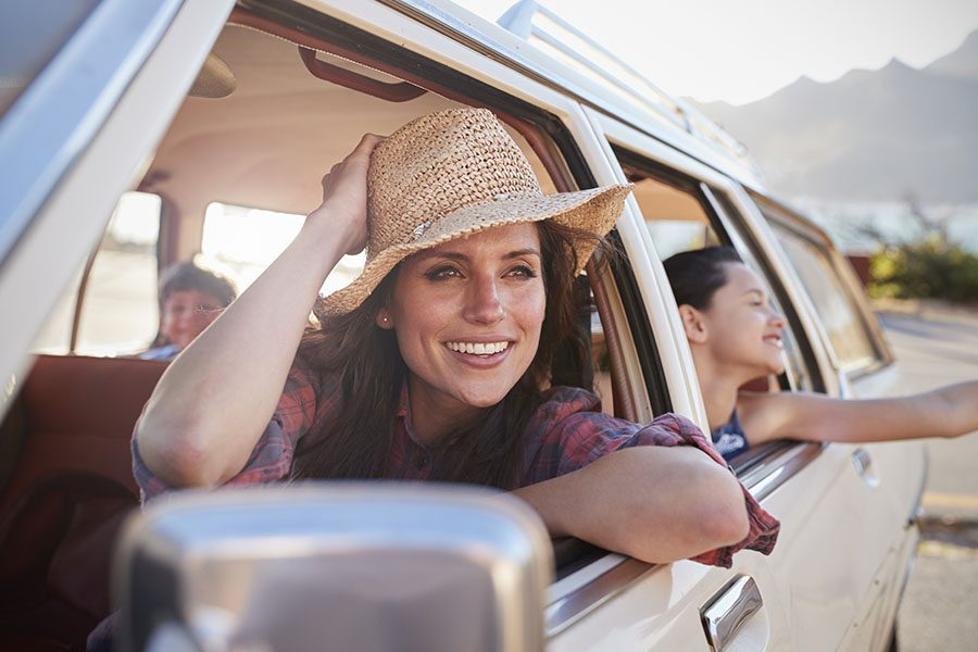 About Our Agency - Mother And Children Having Fun and Relaxing In a Classic Car During a Road Trip