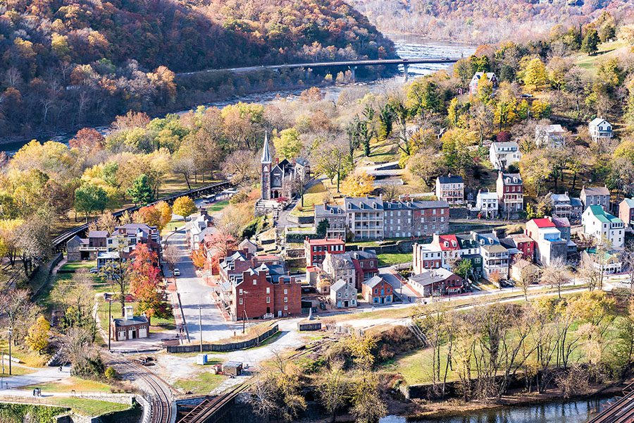 Providence Forge, VA - Closeup of Cityscape with Colorful Foliage of an Autumn Forest with Small Village Town in Virginia