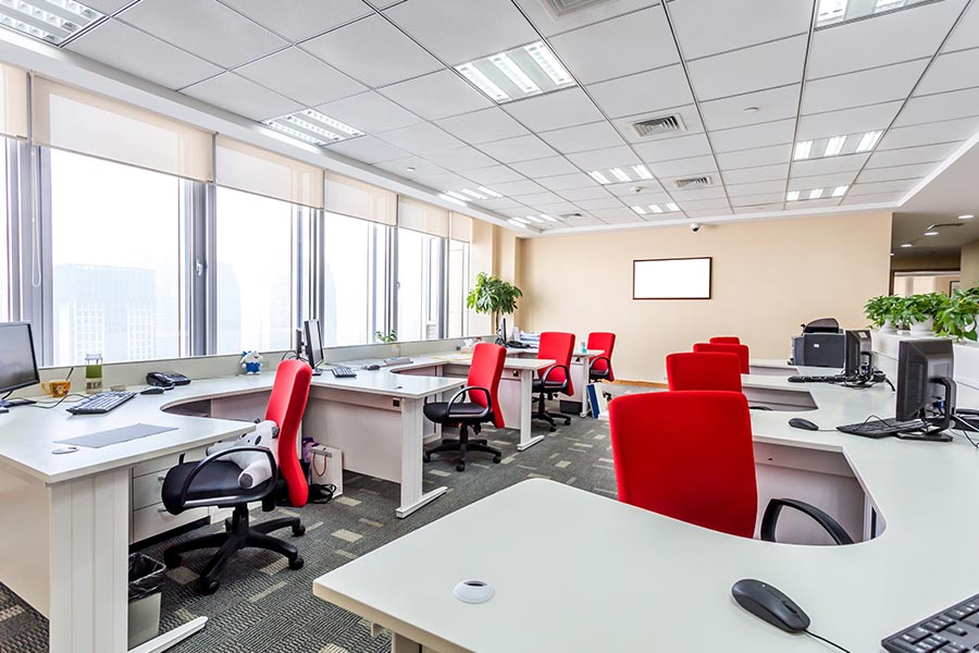 Office Building Insurance - Modern Office with Bright Red Chairs with Big Windows