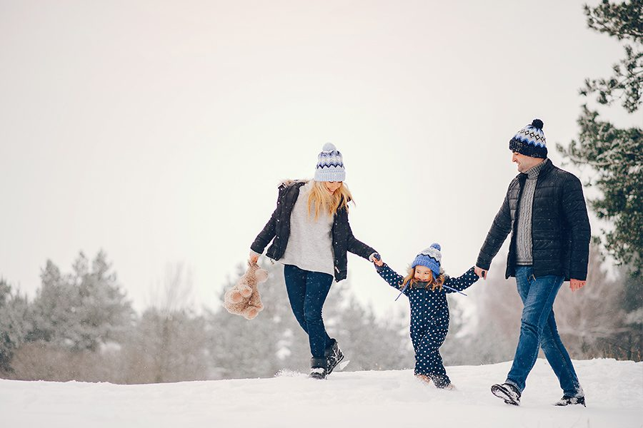 New London, NH - Family Enjoying the Outdoors After Snowfall in Winter