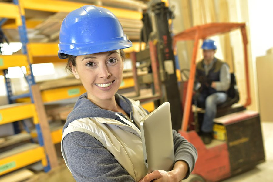 Workers' Compensation Insurance - Smiling Woman Working in Warehouse