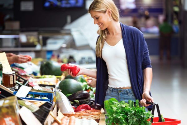 woman buying veggies