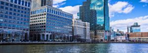 Jersey City NJ Insurance - River Running through Downtown On a Bright Blue Day