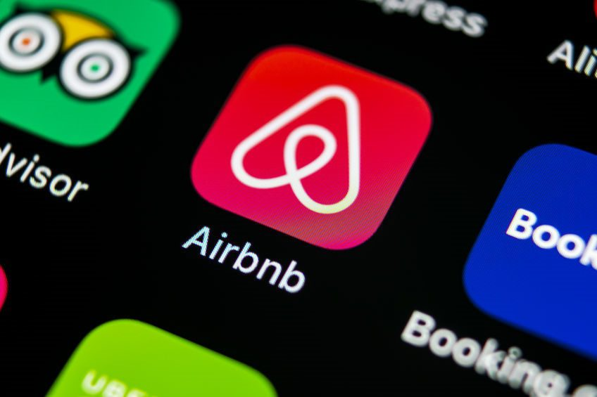 Airbnb application icon on Apple iPhone X screen close-up. Airbnb app icon. Airbnb.com is online website for booking rooms. social media network.