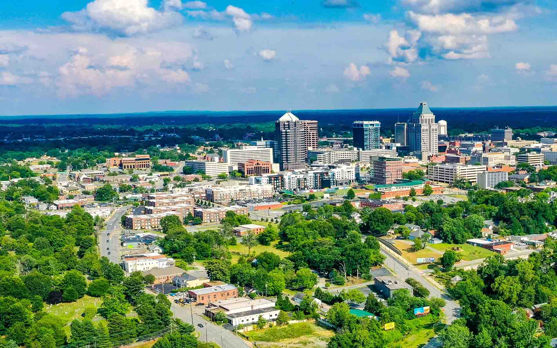 Contact - Aerial View of a City in North Carolina on a Beautiful Day