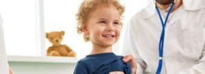 Individual Health Insurance - Child with the Doctor an a Well Visit Appointment