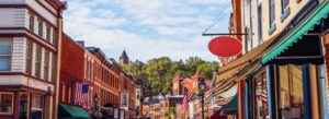 Header - Busy Main Street with Red Sign