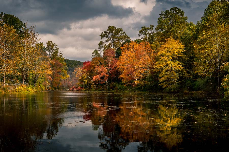 New Jersey - Closeup View of Calm Lake Surrounded by Fall Foliage Reflected in the Water in New Jersey