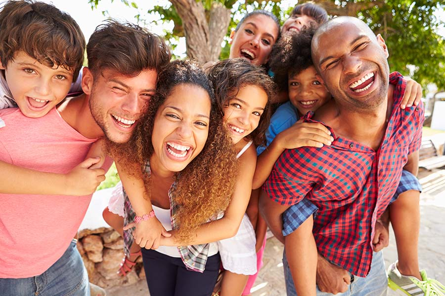 Personal Insurance - Portrait of Group of Happy Families with Kids Having Fun at the Park