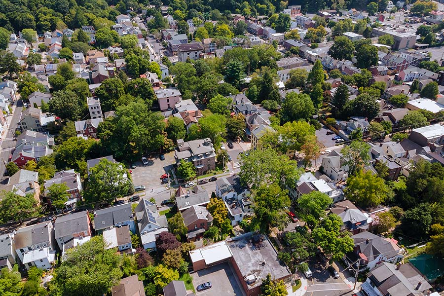 Springfield NJ - Aerial View of Small Town Buildings and Homes Surrounded by Green Foliage in Springfield New Jersey