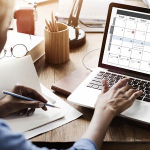 Woman-with-Calendar-on-Laptop