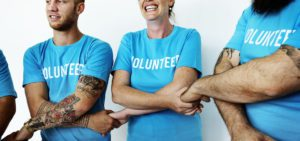 Non-Profit-Insurance-Header-Volunteers-Holding-Hands-and-Embracing