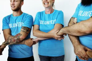 Non-Profit-Insurance-Volunteers-Holding-Hands-and-Embracing