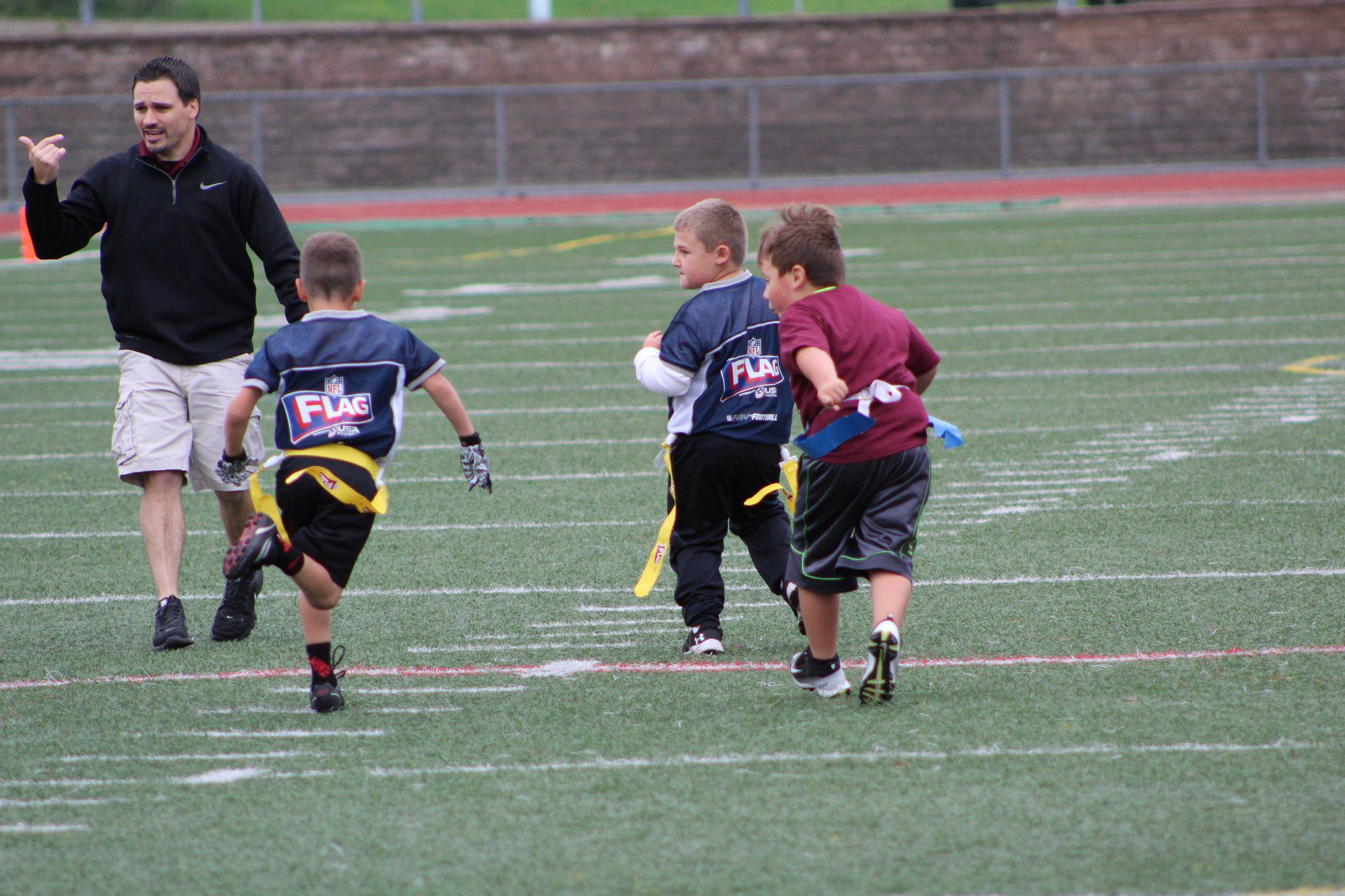 Kyle Youngs coaching a youth sports team.