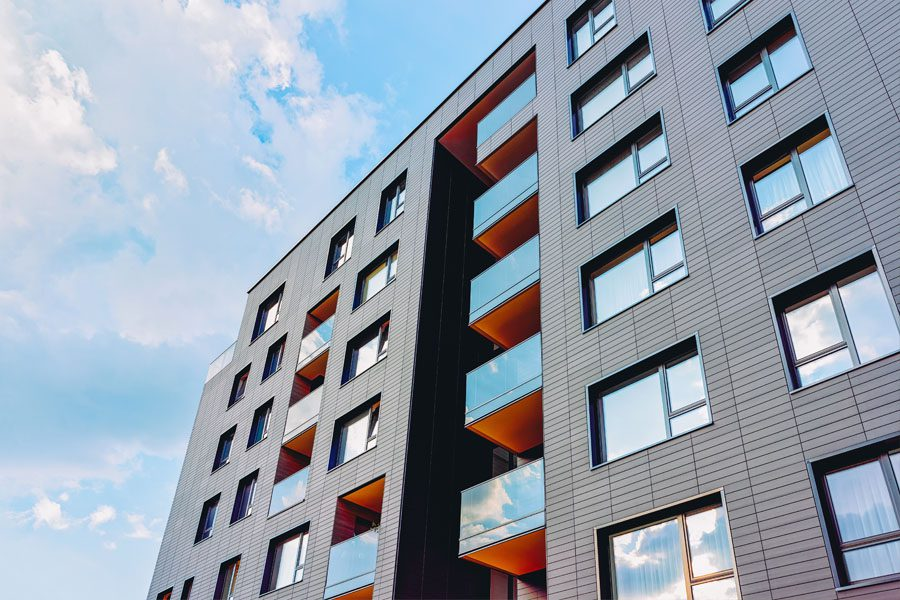 Business Insurance - Apartment Style Building with a Blue Sky