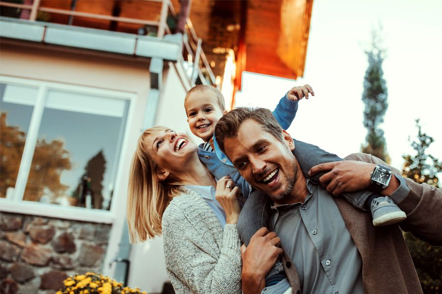 Umbrella Insurance - Family Having Fun Outside of Their Home