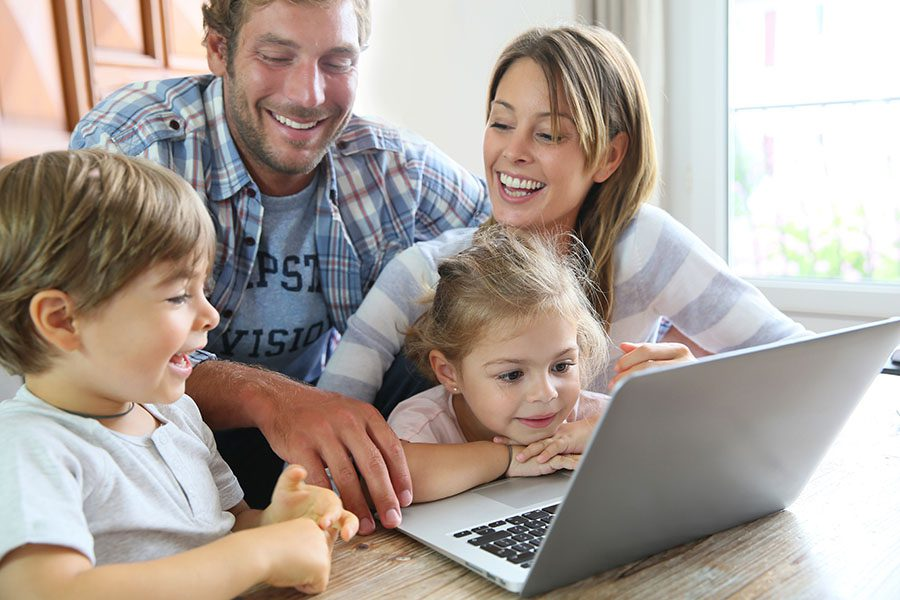 Blog - Happy Family With Kids Using Laptop At Home