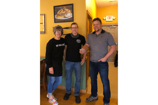 Our Business Partners - Bishops Restaurant owner Denise Dorsey (left) with son Zach Dorsey (center) and Insurance Centre Agency agent Aaron Dorksen