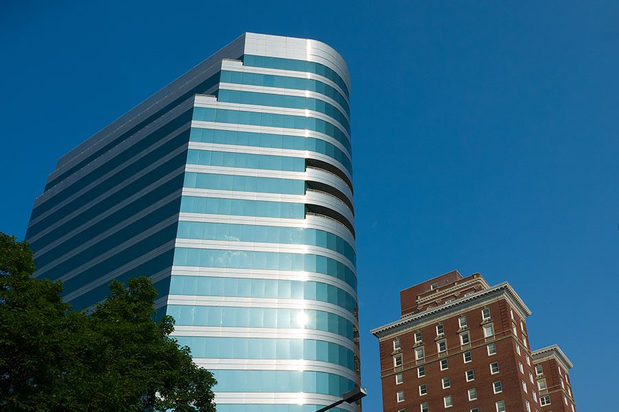 Contact - View of Two Tall Commercial Buildings Against Blue Sky in Knoxville Tennessee