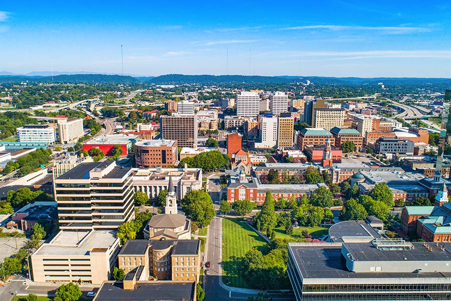 Knoxville TN - Aerial View of Downtown Knoxville Tennessee Against Blue Sky on Sunny Day