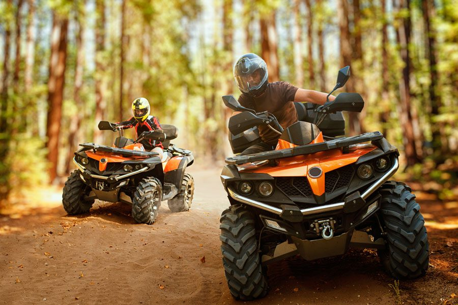 Off-Road Vehicle Insurance - Father and Son Using ATVs