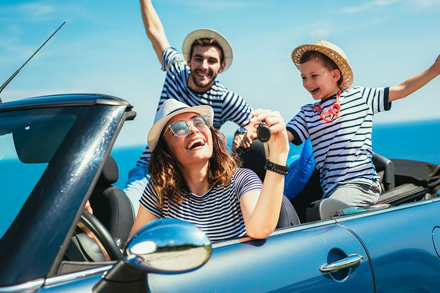 Personal Insurance - View of Cheerful Family Going on a Road Trip for Summer Vacation
