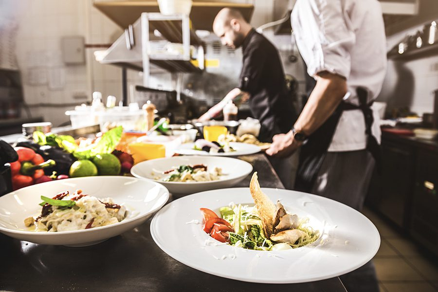 Specialized Business Insurance - Professional Chef Cooking in the Kitchen Restaurant at ta Hotel Near Nashville Tennessee