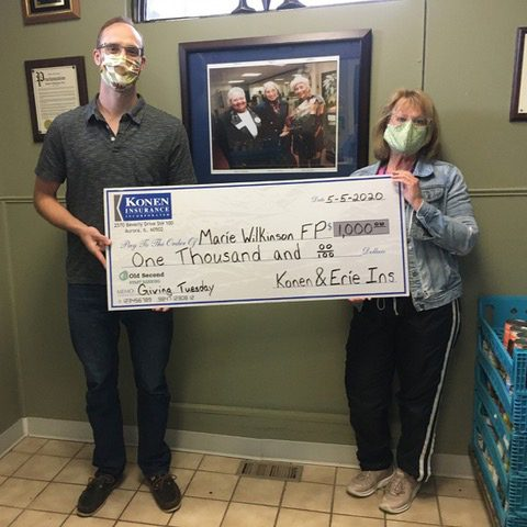Giving Back - Charity Check to Marie Wilkinson for Giving Tuesday