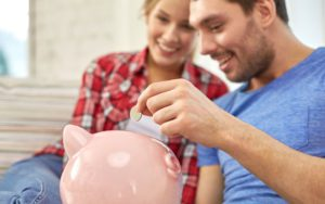 Couple-with-Piggy-Bank