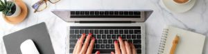 Advice - Woman Hands Using a Laptop to Access Resources, FAQs, and Blogs