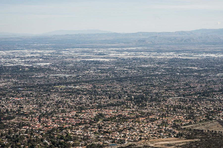 California - Aerial View of the City of Claremont, Upland, Rancho Cucamonga, Montclair, and Pomona from Potato Mountainin California