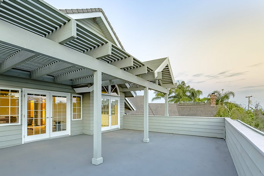 Home Insurance - Large Deck of Southern California Home with Lattice Covering at Twilight