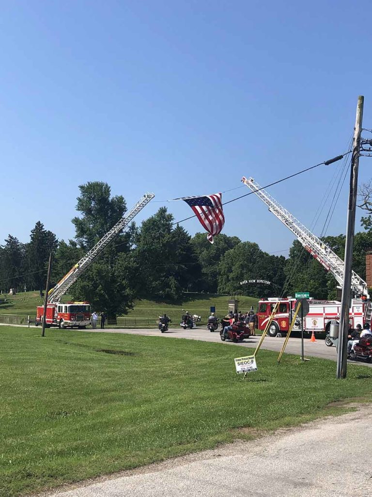 Community Involvement - Ride to Remember Event - American Flag Getting Raised