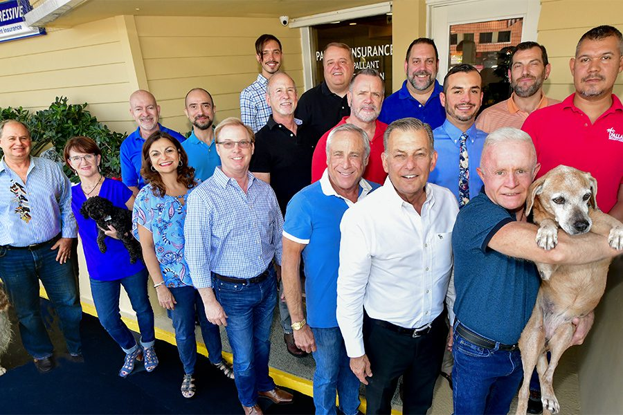 About Our Agency - Group Portrait of the Business Insurance Team Members at Pallant Insurance Agency Standing in Front of Their Fort Lauderdale, Florida Office on a Sunny Day
