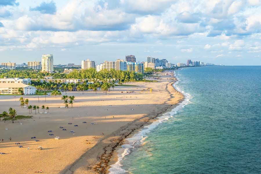 Fort Lauderdale FL - City View Along a Sandy Florida Beach with the Sparkling Blue Waves Coming In