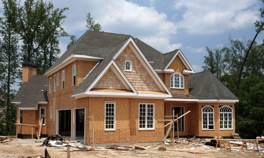 Builders Risk Coverage Understanding the Policy Period - Frontal View of a High Quality Home Under Construction on a Bright Afternoon