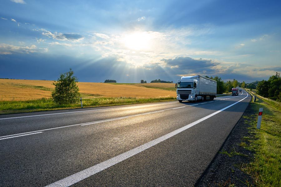 Inland Marine Insurance - Truck Moving Along the Road Transporting Goods