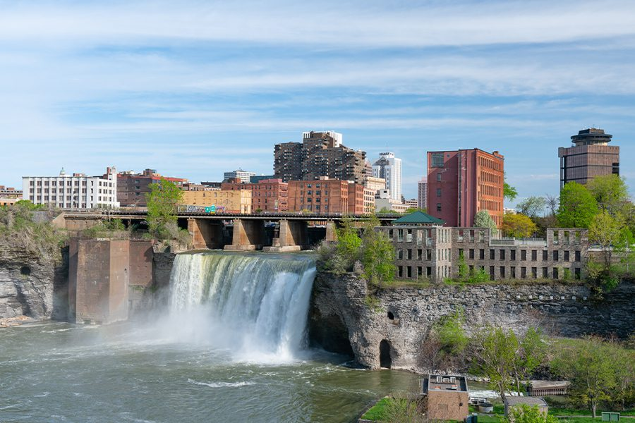 Contact - High Falls of Rochester New York in Front of a City Skyline Surrounded by Trees