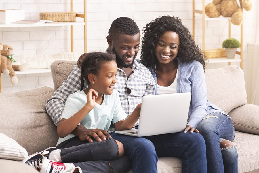 Blog - Happy Family Using Laptop at Home Together