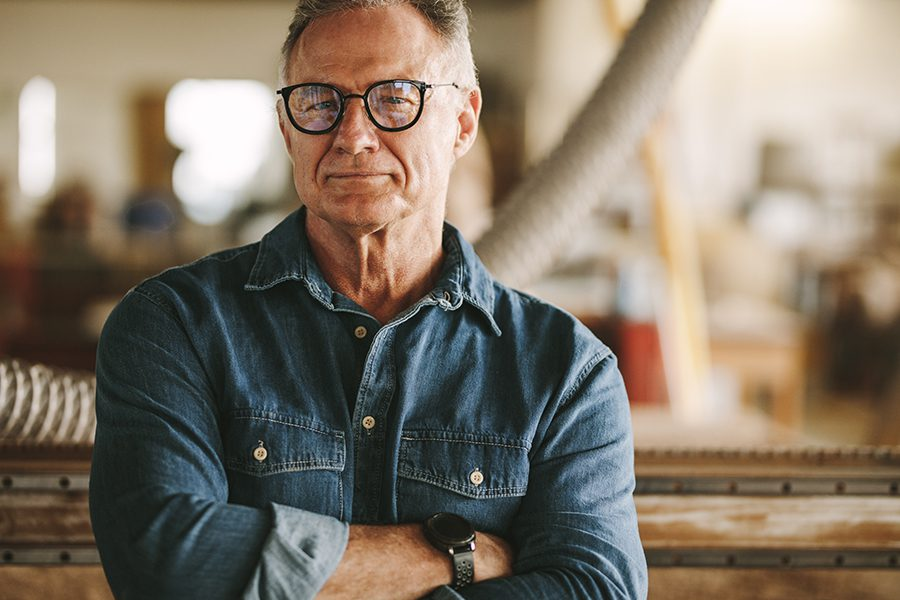 Specialized Business Insurance - Portrait of a Carpentry Workshop Owner in His Workshop