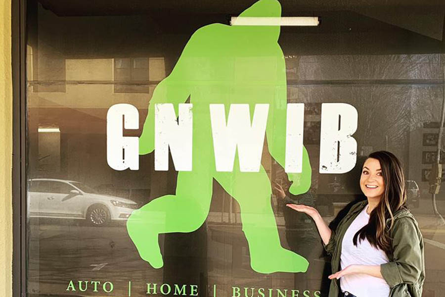 GNWIB - Employee Outside Poitning to the Sign