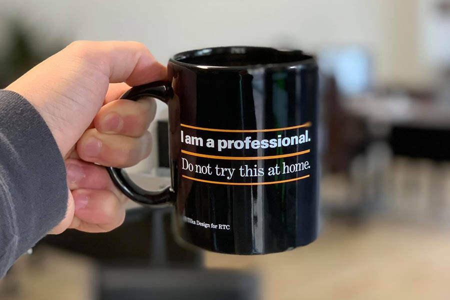 Get an Insurance Quote - Holding Up a Mug from the Office