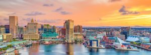 Baltimore, MD Insurance - View of the Baltimore Skyline at Sunset Looking Over the Water