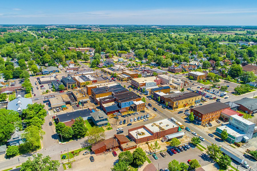 Contact - Small Town Aerial View of in Indiana on a Sunny Summer Day