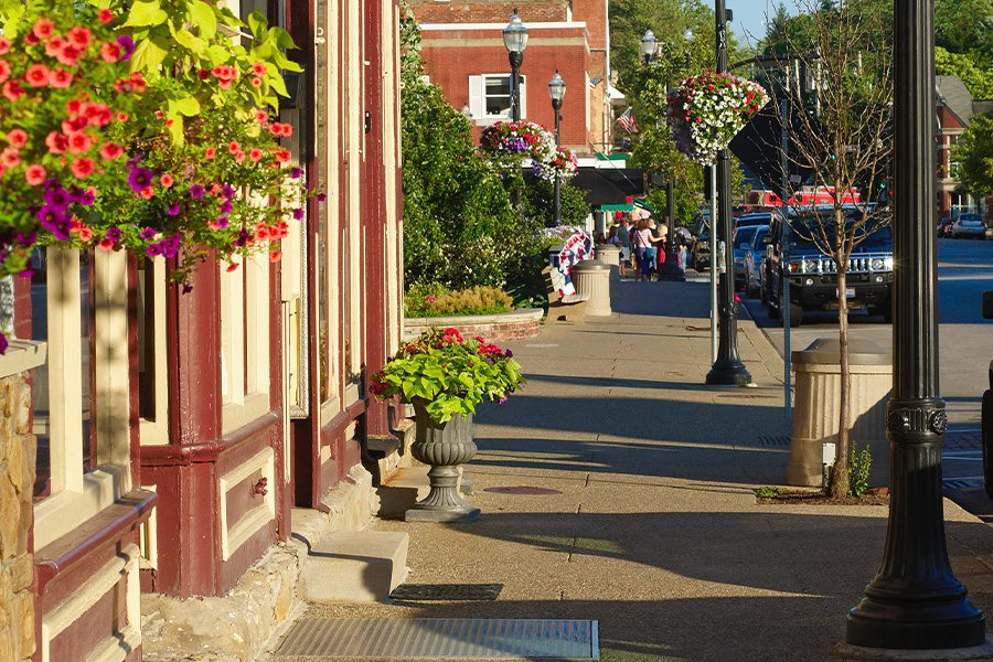 Fortville, IN - Colorful Sidewalk View of Local Stores in Indiana Small Town