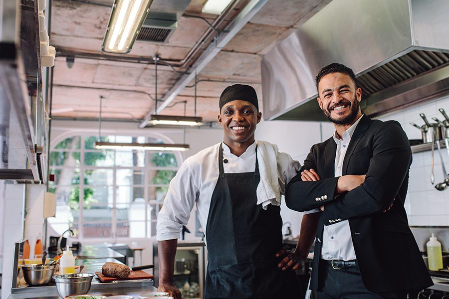 Specialized Business Insurance - Restaurant Owner with Head Chef in the Kitchen